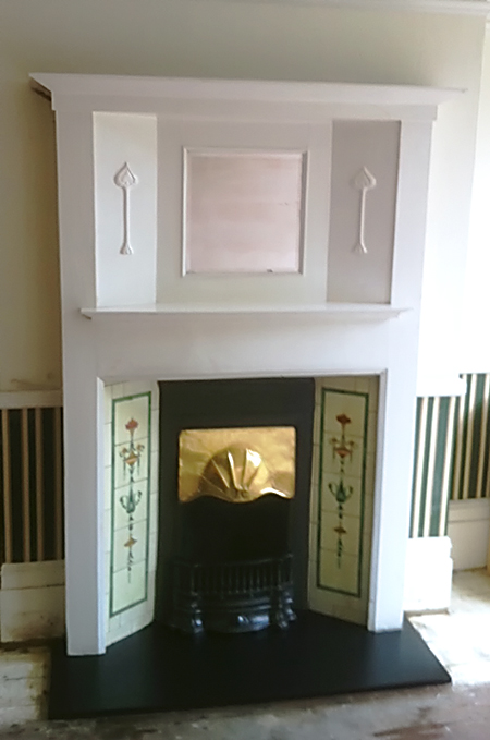 Victorian fireplace with mirror